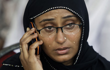 Maryam Aslam weeps while enquiring about her missing brother who worked in a garment factory, in Karachi, Pakistan, Wednesday, Sept. 12, 2012. Pakistani officials say the death toll from devastating factory fires that broke out in two major cities has killed hundreds. (AP Photo/Shakil Adil)