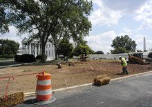 In this Aug. 13, 2012, photo, ground crews finish up renovations to the grounds around the North Lawn of the White House in Washington The White House Big Dig is finally wrapping up, but the Big Reveal is proving to be a pretty big letdown. After nearly two years and $86 million worth of noisy and disruptive construction, the West Wing has emerged from its visual seclusion remarkably unchanged. And deep underground, whatever has been built there remains shrouded in mystery. (AP Photo/Pablo Martinez Monsivais)