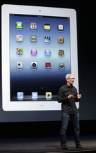 Apple CEO Tim Cook speaks in front of an image of an iPad during an Apple event in San Francisco, Wednesday, Sept. 12, 2012. (AP Photo/Jeff Chiu)