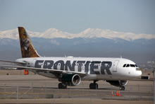 FILE - In this Thursday, April 8, 2010 file photo, a Frontier Airlines jetliner arrives at Denver International Airport. Carriers are offering more deals to passengers who book flights directly on their websites. Frontier Airlines is the latest carrier to jump into the fight, announcing Wednesday, Sept. 12, 2012, that it will penalize passengers who don't book directly with the airline. (AP Photo/David Zalubowski, File)