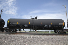 In this Aug. 8, 2012 photo, a DOT-111 rail tanker passes through Council Bluffs, Iowa. For two decades, DOT-111 rail tankers, workhorses of the American rail fleet, have been allowed to haul hazardous liquids from coast to coast even though transportation officials were aware of a dangerous design flaw that almost guarantees the car will tear open in an accident. The rail and chemical industries have committed to a safer design for new tankers, but they do not want to modify tens of thousands of existing cars. That's despite a spike in the number of accidents. (AP Photo/Nati Harnik)