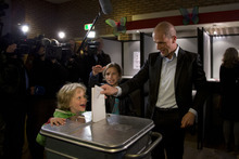 CORRECTING TO SWAP NAMES OF CHILDREN - Labour Party PvdA leader Diederik Samsom casts his vote for parliamentary elections as his six-year-old son Fane, left, and eleven-year-old daughter Benthe, center rear, look on at a polling station in Leiden, central Netherlands, Wednesday Sept. 12, 2012. (AP Photo/Peter Dejong)