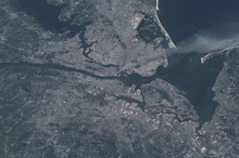 This image provided by NASA shows a smoke plume rising from the Manhattan area after two planes crashed into the towers of the World Trade Center. This photo was taken from the International Space Station of metropolitan New York City (and other parts of New York as well as New Jersey) the morning of Sept. 11, 2001. (AP Photo/NASA, Frank Culbertson)