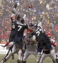 Tribune file photo BYU defenders leap up, attempting unsuccessfully to block Utah's only score of the game in 2003.