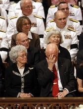 Astronaut, and former Ohio Sen. John Glenn, accompanied by his wife Annie, pauses at the Washington National Cathedral in Washington, Thursday, Sept. 13, 2012, during a national memorial service for the first man to walk on the moon, Neil Armstrong. (AP Photo/Ann Heisenfelt)