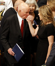 Astronaut, and former Ohio Sen. John Glenn kisses singer Diana Krall's hand at the Washington National Cathedral in Washington, Thursday, Sept. 13, 2012, following a national memorial service for the first man to walk on the moon, Neil Armstrong. (AP Photo/Ann Heisenfelt)