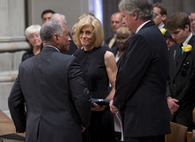 Carol Armstrong, wife of Apollo 11 astronaut Neil Armstrong is presented with a flag by NASA administrator Charles Bolden, as his son Rick Armstrong looks on at right, Thursday, Sept. 13, 2012, during a memorial service at the National Cathedral in Washington.  (AP Photo/Pool, Evan Vucci, Pool)