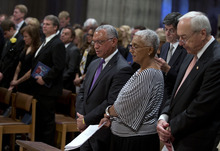 Former astronaut and NASA administrator Charles Bolden, left, and his wife Alexis Bolden pause during a memorial service for Apollo 11 astronaut Neil Armstrong, Thursday, Sept. 13, 2012, at the National Cathedral in Washington.  (AP Photo/Pool, Evan Vucci)