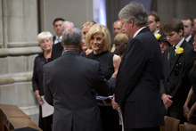 Carol Armstrong, wife of Apollo 11 astronaut Neil Armstrong is presented with a flag by NASA Administrator Charles Bolden during a memorial service, Thursday, Sept. 13, 2012, at the National Cathedral in Washington.  (AP Photo/Pool, Evan Vucci, Pool)