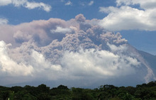 In this image with a cell phone, plumes of smoke rise from the Volcan de Fuego or Volcano of Fire as seen from Palin, south of Guatemala City, Thursday, Sept. 13, 2012. The volcano is spewing lava and ash and the director of the national disaster agency says officials are carrying out