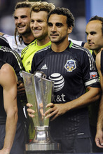 MLS All-Stars' Dwayne De Rosario, of D.C. United, holds the trophy after defeating Chelsea FC 3-2 in soccer's MLS All-Star game, Wednesday, July 25, 2012, in Chester, Pa. (AP Photo/Michael Perez)