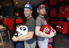 Al Hartmann  |  The Salt Lake Tribune Trevor Grigg, left, and Joe Bunt, co-owners of new the U Rivals store in The Gateway, are counting on the BYU-Utah rivalry to help make their business a success. Both are graduates and fans of Boise State.