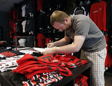 Al Hartmann  |  The Salt Lake Tribune  Joe Bunt and his partners in the new U Rivals store at The Gateway offer a variety of collegiate merchandise, specializing in the University of Utah and Brigham Young University.