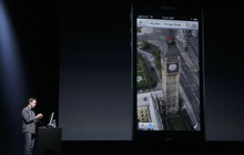 Scott Forstall, Apple's senior vice president of iOS Software, shows features on the iPhone 5 during an Apple event in San Francisco, Wednesday, Sept. 12, 2012. (AP Photo/Jeff Chiu)
