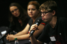 Francisco Kjolseth     The Salt Lake Tribune Alex Libby, 15, right, answers questions from Utah middle school students following a screening of the film