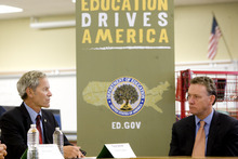 Kim Raff | The Salt Lake Tribune (right) U.S. Department of Education Assistant Secretary Peter Cunningham listens as Salt Lake Mayor Ralph Becker speaks during a round table at Glendale Middle School, one of many stops on the Education Department's 2012 cross-country, back-to-school bus tour,