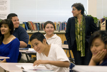 Kim Raff | The Salt Lake Tribune U.S. Education Chief of Staff Joanne Weiss listens in on an 8th grade reading class during a visit to Glendale Middle School, one of many stops on the Education Department's 2012 cross-country, back-to-school bus tour,