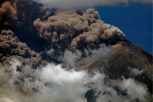 Volcanic ash spews from the Volcan de Fuego or Volcano of Fire as seen from Palin, south of Guatemala City, Thursday, Sept. 13, 2012. The long-simmering volcano exploded into a series of powerful eruptions Thursday, hurling thick clouds of ash nearly two miles (three kilometers) high, spewing rivers of lava down its flanks and forcing the evacuation of more than 33,000 people from surrounding communities. (AP Photo/Moises Castillo)