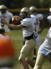 Francisco Kjolseth  |  The Salt Lake Tribune Skyline Quarterback Tyler Snyder works out with the team during a recent practice.