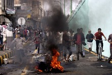 Protesters run as police, unseen, open fire into the air near the U.S. Embassy during a protest about a film ridiculing Islam's Prophet Muhammad, in Sanaa, Yemen, Thursday, Sept. 13, 2012. Yemen's president has apologized to President Barack Obama for the attack on the U.S. Embassy in Sanaa, the Yemeni capital, by a mob angry over an anti-Islam film. (AP Photo/Hani Mohammed)
