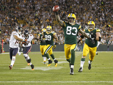 Green Bay Packers' Tom Crabtree (83) celebrates as he scores a touchdown on a pass from punter Tim Masthay during the first half of an NFL football game against the Chicago Bears Thursday, Sept. 13, 2012, in Green Bay, Wis. (AP Photo/Jeffrey Phelps)