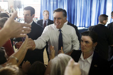 Republican presidential candidate and former Massachusetts Gov. Mitt Romney greets supporters at his campaign headquarters in Jacksonville, Fla.,  Wednesday, Sept. 12, 2012. (AP Photo/Charles Dharapak)