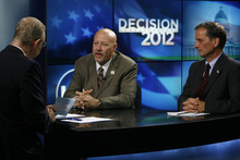 Francisco Kjolseth  |  The Salt Lake Tribune KSL reporter Rich Piatt, left, conducts the first debate between 2nd Congressional District candidates Jay Seegmiller, center, and Chris Stewart on Thursday, Sept. 13, 2012.