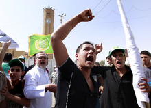 Iraqis chant slogans during a protest in Baghdad, Iraq, Friday, Sept. 14, 2012. Hundreds of Iraqis demonstrated in Baghdad's northern Sunni neighborhood of Azamiyah to protest the anti-Muslim film, demanding the U.S. government to punish those who behind it and not to play it in any country. (AP Photo/Hadi Mizban)