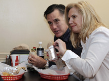 Republican presidential candidate, former Mass. Gov. Mitt Romney and his wife Ann eat burritos at Dos Amigos Burritos while campaigning in Concord, N.H. Friday, Dec. 23, 2011. (AP Photo/Winslow Townson)