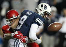 BYU quarterback Jake Heaps (9) fumbles the football as he is hit by Utah linebacker Trevor Reilly (49) during the second half of an NCAA college football game, Saturday, Sept. 17, 2011, at LaVell Edwards Stadium in Provo. (AP Photo/Colin E Braley)