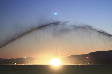 Mario E. Ruiz  |  Special to the Tribune  Frontier Airlines flight 1655 taxis in as firetrucks fire a water arch at the Provo Airport on Monday, June 20, 2011. Frontier Airlines will begin offering daily flights from the Provo Airport.