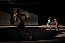 Syrian children play in the street in the Bustan Al Qsar district in Aleppo, Syria, Wednesday, Sept. 12, 2012. (AP Photo/ Manu Brabo)
