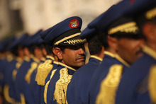 A Yemeni honor guard looks back as he stands at attention with fellow during a funeral of soldiers who were killed in a car bomb attack targeting the motorcade of the country's defense minister in Sanaa, Yemen, Thursday, Sept. 13, 2012. (AP Photo/Hani Mohammed)