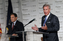 Al Hartmann  |  The Salt Lake Tribune Gov. Gary Herbert, left, waits his turn to respond to criticisms of challenger Peter Cooke during a debate Friday before the Utah League of Cities and Towns.