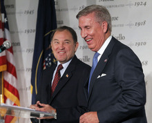 Al Hartmann  |  The Salt Lake Tribune Democrat Peter Cooke, right, and Gov. Gary Herbert, a Republican, share a chuckle Friday during a gubernatorial debate that contained some sharp back-and-forth between the candidates.