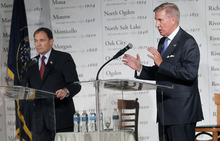 Al Hartmann     The Salt Lake Tribune Gov. Gary Herbert, left, defended Utah's economic and education track record against sharp criticisms from challenger Peter Cooke during a debate Friday hosted by the Utah League of Cities and Towns.