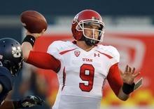 Trent Nelson  |  The Salt Lake Tribune Utah quarterback Jon Hays throws the ball against Utah State in Logan on Sept. 7, 2012.
