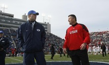 Chris Detrick | The Salt Lake Tribune  BYU head coach Bronco Mendenhall and Utah head coach Kyle Whittingham meet at the center of the field before the start of the 2009 rivalry game in Provo.