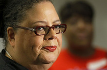 Karen Lewis, president of the Chicago teachers union listens to a question after meeting of the union's House of Delegates Friday, Sept. 14, 2012, in Chicago. Lewis told the delegates that a