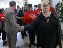 Karen Lewis, president of the Chicago teachers union, departs a news conference after her meeting with the union's House of Delegates Friday, Sept. 14, 2012, in Chicago. Lewis told the delegates that a