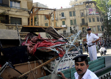 Egyptian police load furniture and other items confiscated from street vendors as they clear Tahrir Square in Cairo, Egypt, Saturday, Sept. 15, 2012 after days of protests near the U.S. embassy over a film insulting Prophet Muhammad. (AP Photo/Mohammed Asad)