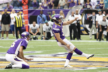 Minnesota Vikings kicker Blair Walsh, kicks a field goal as holder Chris Kluwe, left, looks on during the second half of an NFL football game against the Jacksonville Jaguars Sunday, Sept. 9, 2012, in Minneapolis. (AP Photo/Genevieve Ross)