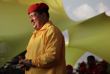 FILE - In this July 14, 2012 file photo, Venezuela's President Hugo Chavez smiles at a campaign rally in Barquisimeto, Venezuela. When he takes the stage at campaign rallies, Chavez stands alone. Under Venezuela's election system, presidential hopefuls don't choose running mates. The lack of a No. 2 leaves voters with a big unknown ahead of next month's presidential election and raises question about who in fact would take over were Chavez to win and leave office prematurely. (AP Photo/Ariana Cubillos,File)