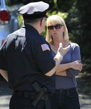 Kate Quigley, right, who says her brother Glen Doherty was among the Americans killed in an attack on the U.S. Consulate in Libya, speaks with Woburn, Mass. Police Chief Robert Ferullo, left, in Worburn, Thursday, Sept. 13, 2012. Four Americans were killed at the U.S. Consulate in Benghazi on Tuesday along with U.S. Ambassador Chris Stevens. (AP Photo/Steven Senne)