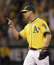 Oakland Athletics' Grant Balfour celebrates at the end of a baseball game against the Baltimore Orioles, Saturday, Sept. 15, 2012, in Oakland, Calif. (AP Photo/Ben Margot)