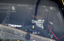 Jimmie Johnson sits in his car during practice for the NASCAR Sprint Cup Series auto race at Chicagoland Speedway in Joliet, Ill., Friday, Sept. 14, 2012. (AP Photo/Nam Y. Huh)
