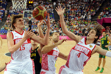 FILE - This Aug. 8, 2012 file photo shows Russian forwards Andrei Kirilenko, left, Sergey Monya, center, and guard Alexey Shved, right, during a men's quarterfinal basketball game at the 2012 Summer Olympics in London. Kirilenko and Shved have enjoyed themselves in Russia ever since winning bronze at the Olympics. Now they're using that popularity to help grow the game in Russia and get ready to play for the Minnesota Timberwolves. (AP Photo/Mark Ralston, Pool)