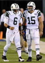 Bill Kostroun  |  AP file photo Mark Sanchez may have thrown three TDs, but it's Tim Tebow's shirtless torso that gets all the attention.