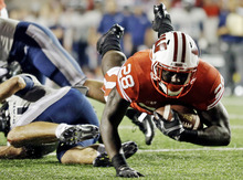 Wisconsin's Montee Ball is tripped up near the goal line during the first half of an NCAA college football game against Utah State, Saturday, Sept. 15, 2012, in Madison, Wis. (AP Photo/Morry Gash)