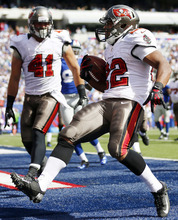 Tampa Bay Buccaneers running back Doug Martin (22) celebrates with  Erik Lorig (41) after rushing for a touchdown during the first half of an NFL football game against the New York Giants, Sunday, Sept. 16, 2012, in East Rutherford, N.J. (AP Photo/Julio Cortez)